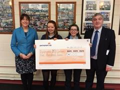 Students present cheque to Dsypraxia Ireland after success of West Cork Colouring Books.